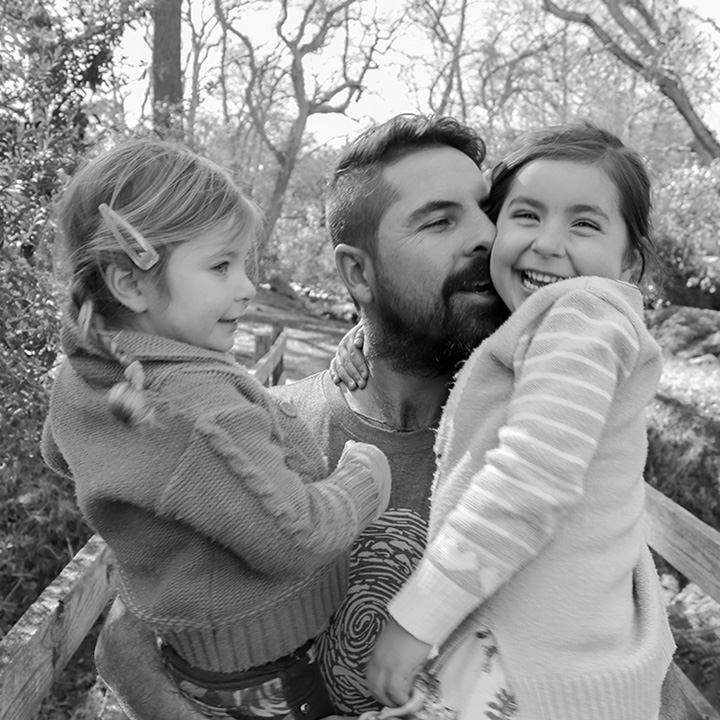 Ross with his two daughters
